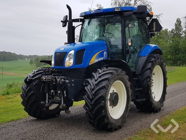 Buy a used New Holland TS100 A Tractor with front lift - 05